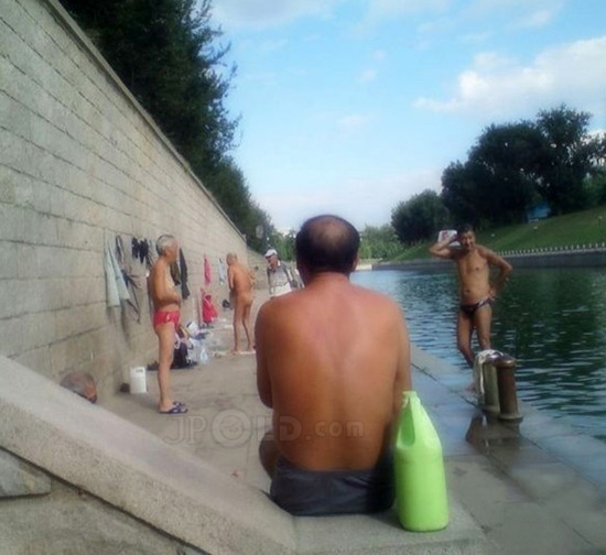 Swimming old men by the river in morning