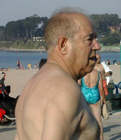 Swimming old man in beach pants at the sea