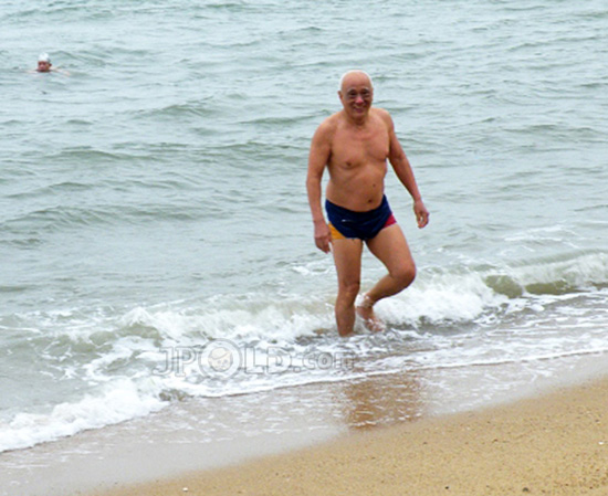Tourists old men out of sea water