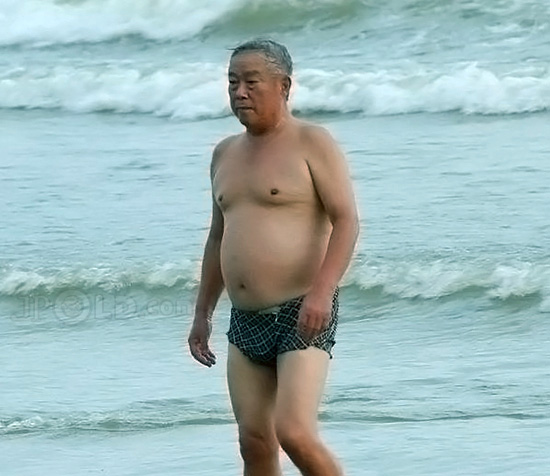 Swimming old daddy in plaid underwear at the sea