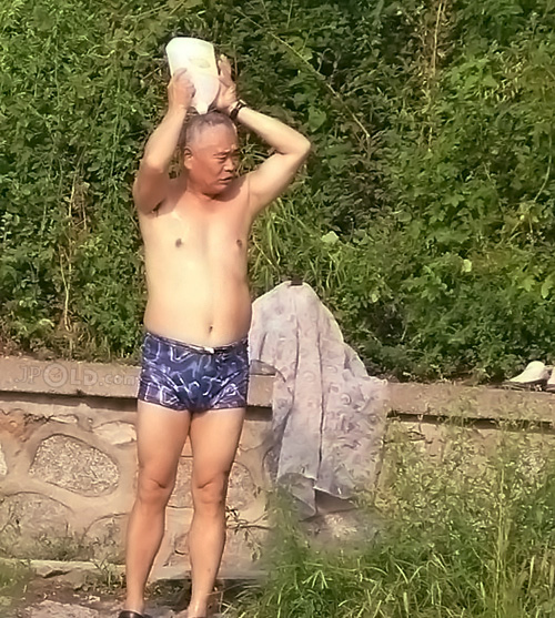 Swimming old daddy in blue plaid underwear bathing by the lake