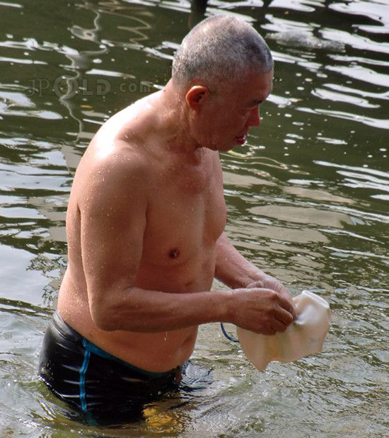 Old daddy in black underwear out of river