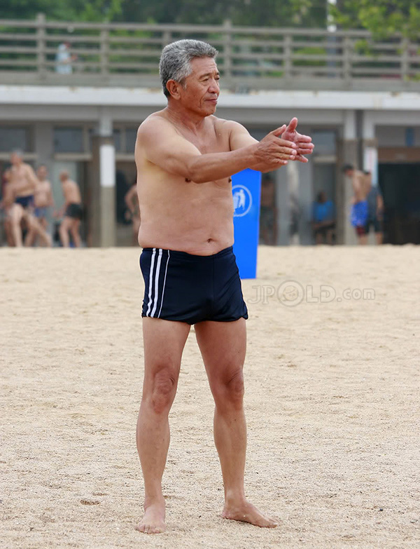 Two swimming old men in black underwears at the sea