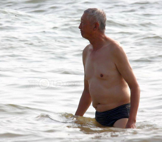 Old man in underwear at the sea