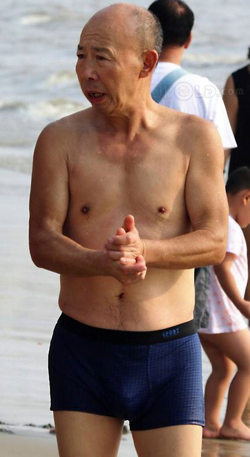 Old daddy in purple underwear at the sea