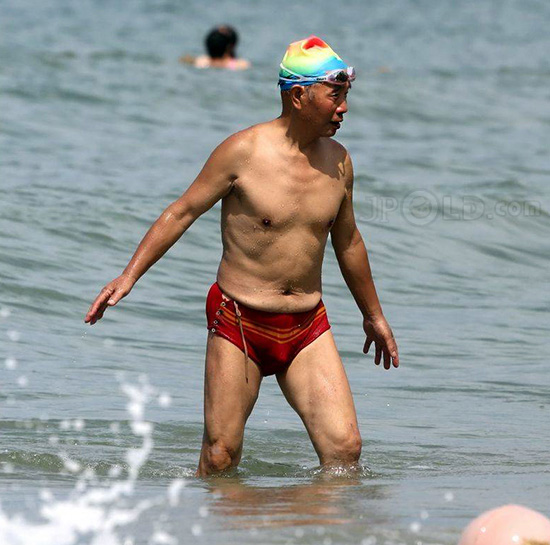 Tourists swimming old daddies on the beach