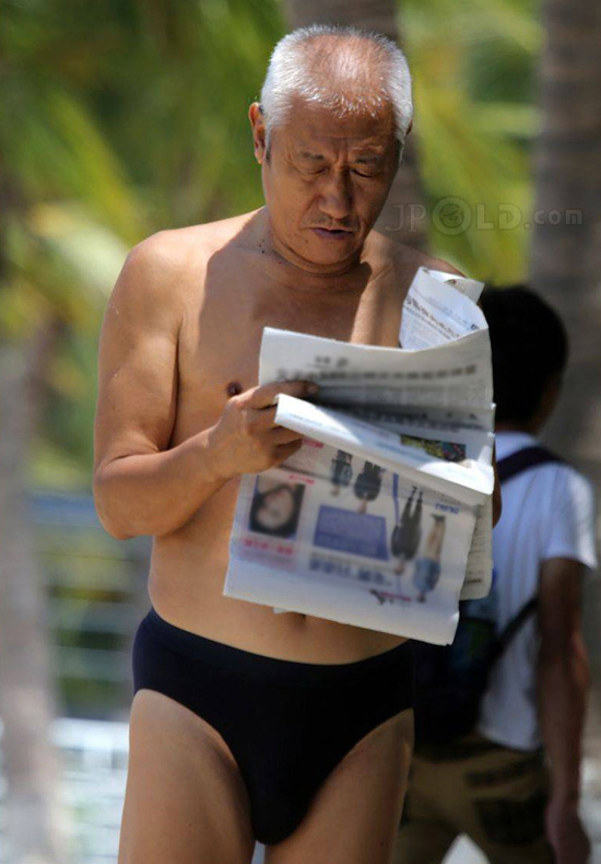 White hair swimming old daddy in black underwear reading newpapers