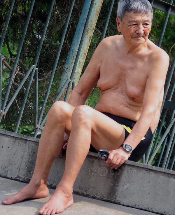 Swimming grandpa was changing his light blue pants