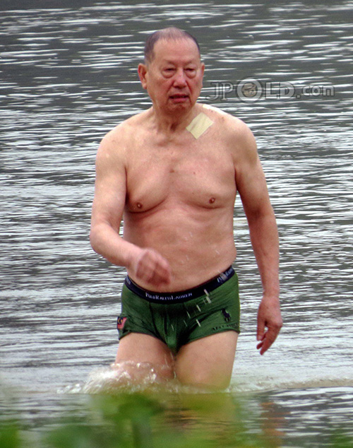 Swimming daddy in green pants out of river