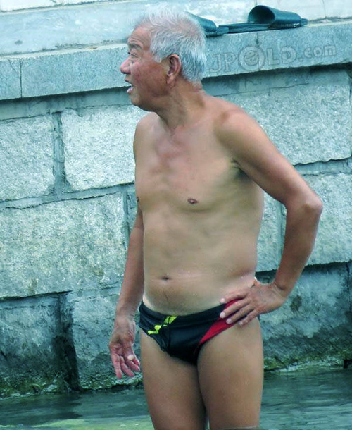Thin swimming old man in a black underwear by river - Page