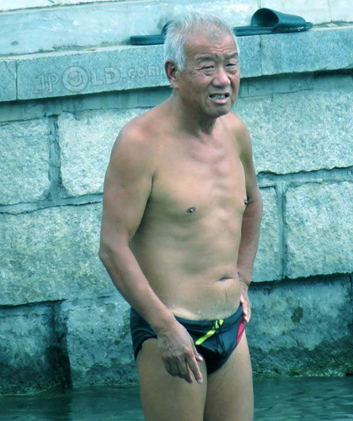 Skinny old man in black underwear goes swimming - Page of
