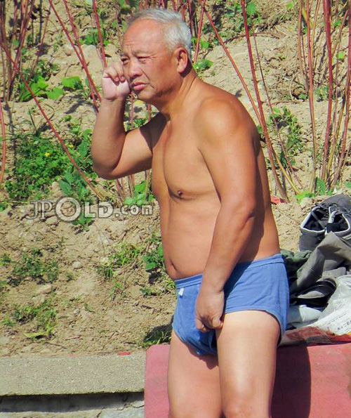 Swimming old daddy in blue underwear by the lake