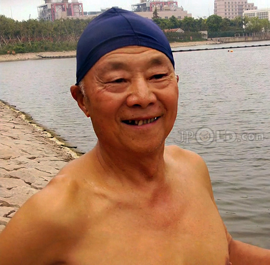 Swimming grandpa in black underwear by the river
