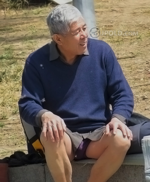 Silver hair swimming old man was changing his purple underwear