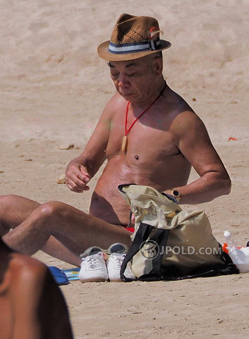 Swimming old daddy in black and red underwear at the sea