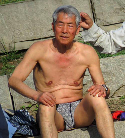 Belly old daddy in black underwear to swimming in river