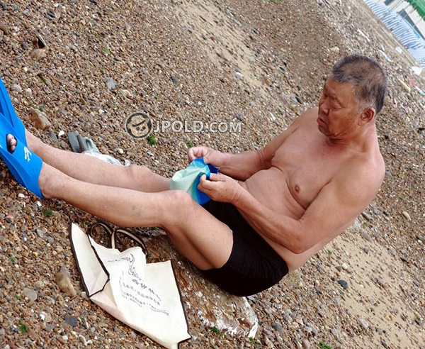 Swimming old daddy in black boxer pants at the sea