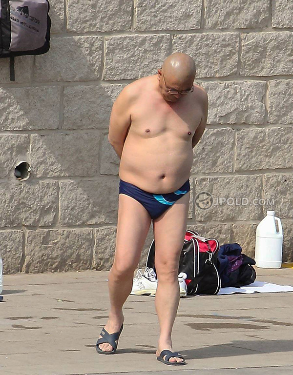 Bald glasses swim daddy stood by the river
