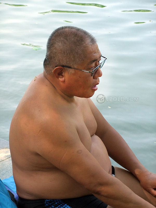 Glasses swimming old daddy sit by the river