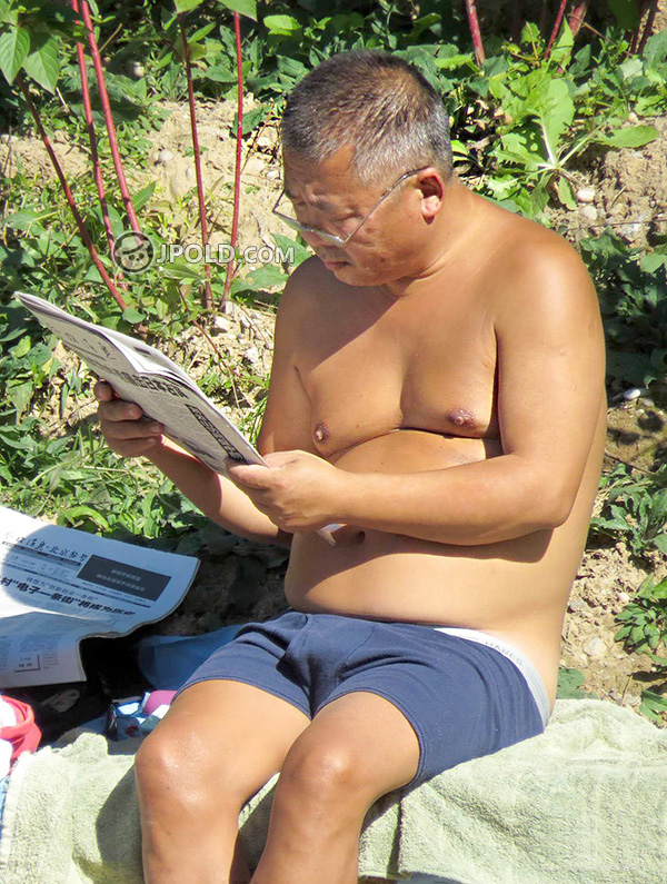 Glasses swim old daddy in a blue underwear was reading