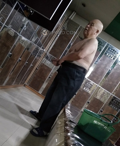 Nice bald head old man in the rest-room