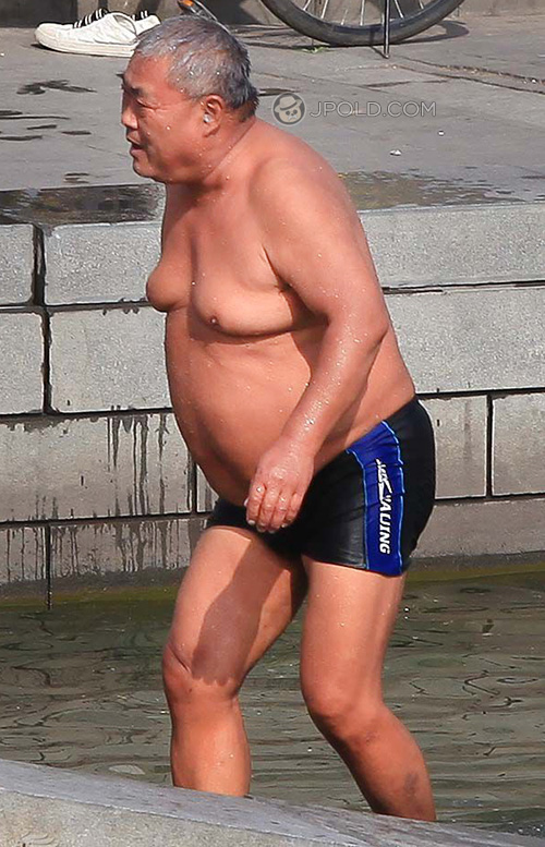 Fat strong old daddy in a black underpants by the river