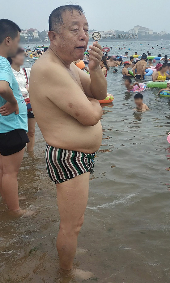Swimming old men in a underwear on the beach