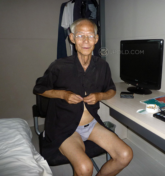 Thin white hair glasses old man smoke in the bedroom