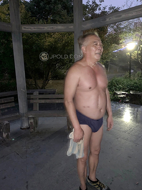 Old daddy in a blue underwear exercised in the morning