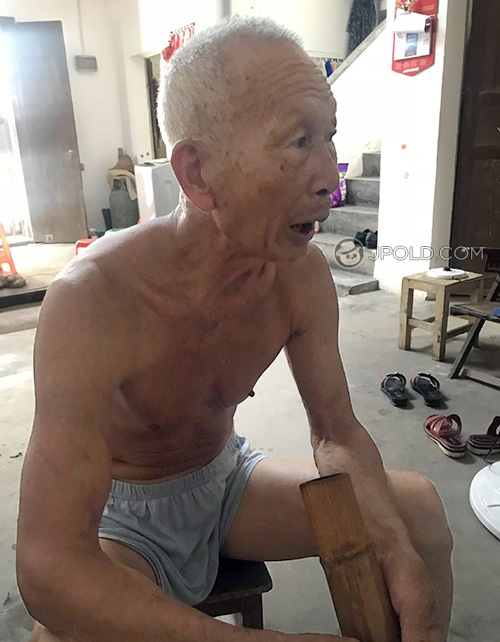Thin old man in a underwear smoke at home