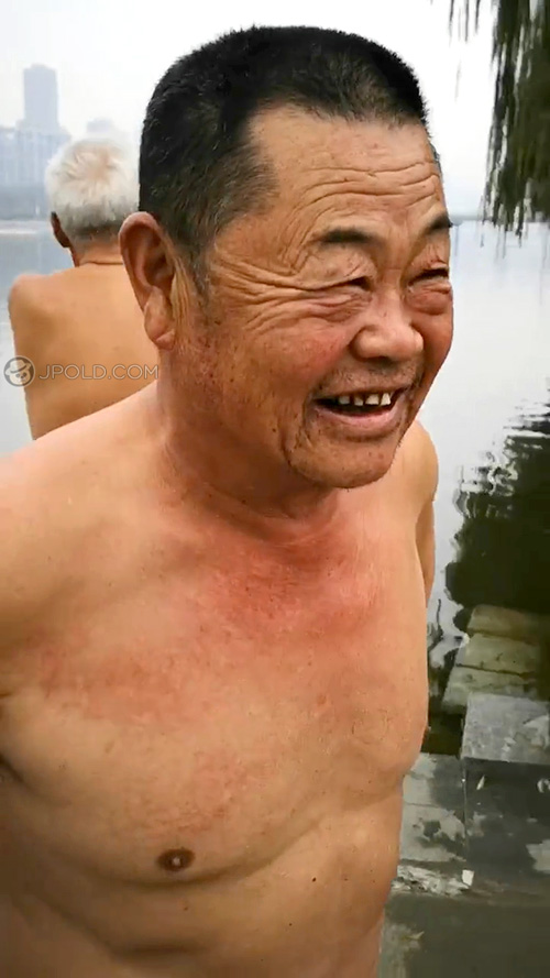 Swimming old daddy in a black underwear by the river