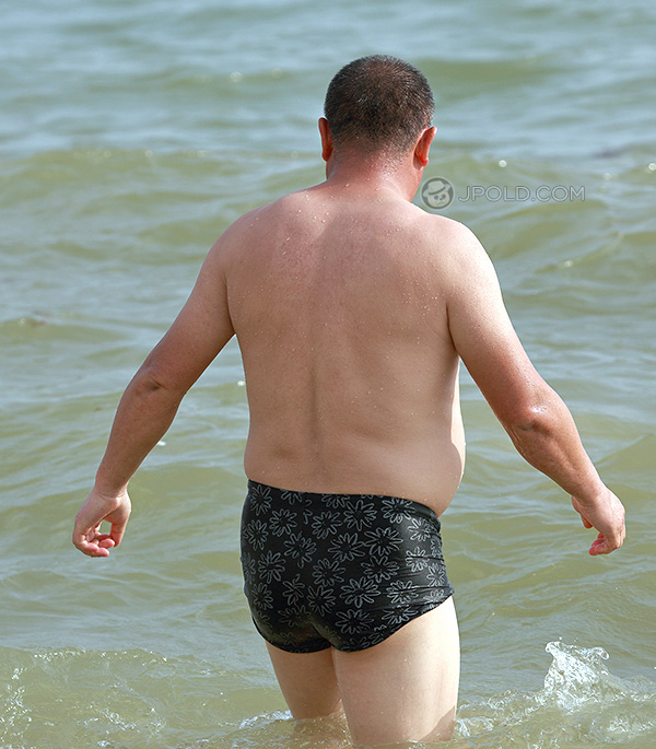 Swimming daddy in a plaid black underwear at the sea