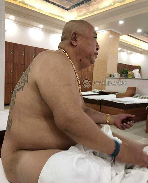 Tattoo fat old daddy in the public rest-room