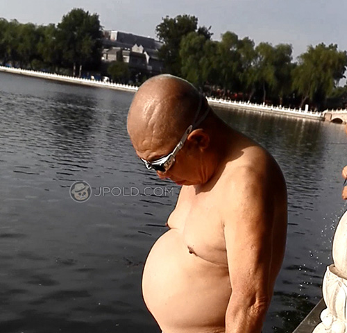 Beer belly old man in a underwear went swimming