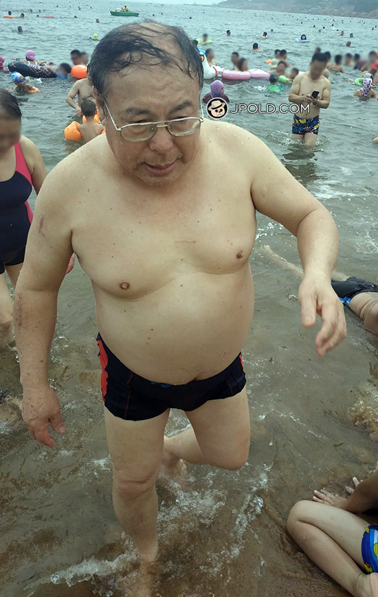 Two old men in boxer underwear on the beach