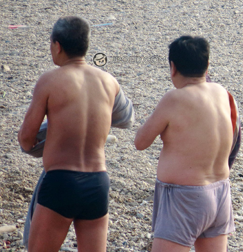 Two swimming old daddy in a boxer underwear on the beach