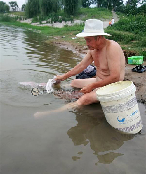 Grandpa was washing his underwear by the river
