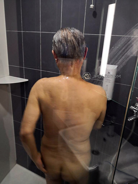 Sliver hair old man enjoyed shower in the hotel